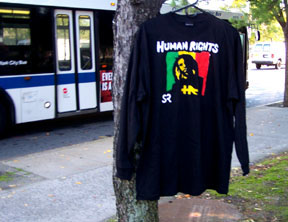 HR/HUMAN RIGHTS hand-painted tee-shirt front. This design is the latest installment  of the Wild Dread design printed and published in 1992.