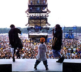 Roguish Performing At Woodstock, 94. Ilchuck (left), Chip (right). That little dude on stage is Doc's (Bad Brains' Guitz) son.