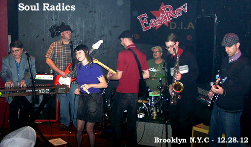 Soul Radics: Nashville-Ska-Rocksteady-Reggae-Punk krew live at EastRev Brooklyn NYC 12.28.12. left to right: Rob Hoskins (Keys; AK Rudies member), Jamie Danish (bass), Dani Radics Casler (throat), Jason Moore (guitz),  Drummy Dave (Drums),  Nels Noseworthy (sax), Shane Callahan (guitz).